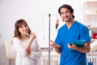 nurse assisting patient